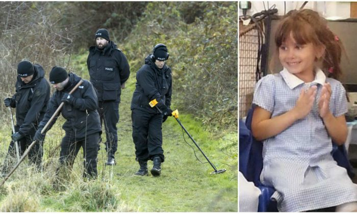 Police search a path leading to the field where the body of 7-year-old Katie Rough was found, in the Woodthorpe area of York, England, Wednesday Jan. 11, 2017. A 15-year-old girl has appeared in court charged with the murder of a 7-year-old who was found badly injured on a playing field and later died. (Danny Lawson/PA via AP)