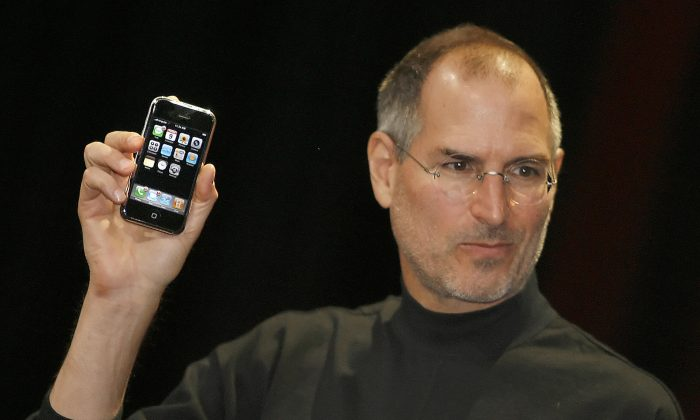 Apple chief executive Steve Jobs unveils the original iPhone at the Macworld Conference on Jan. 9, 2007 in San Francisco. Jobs is one of many Americans who failed many times, until he succeeded wildly. (Tony Avelar/AFP/Getty Images)
