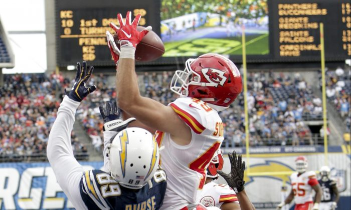 Kansas City Chiefs defensive back Daniel Sorensen (R) intercepts a pass intended for San Diego Chargers wide receiver Isaiah Burse (89) during the first half of an NFL football game in San Diego on  Jan. 1, 2017. (AP Photo/Rick Scuteri)