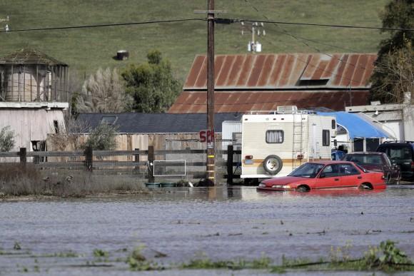 Floodwaters surround a property in Hollister, Calif., on Jan. 11, 2017. (AP Photo/Marcio Jose Sanchez)