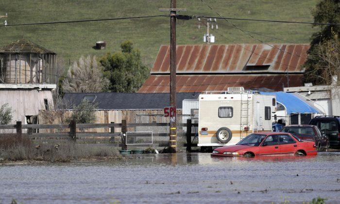 Floodwaters surround a property in Hollister, Calif., on Jan. 11, 2017. (Marcio Jose Sanchez/AP Photo)