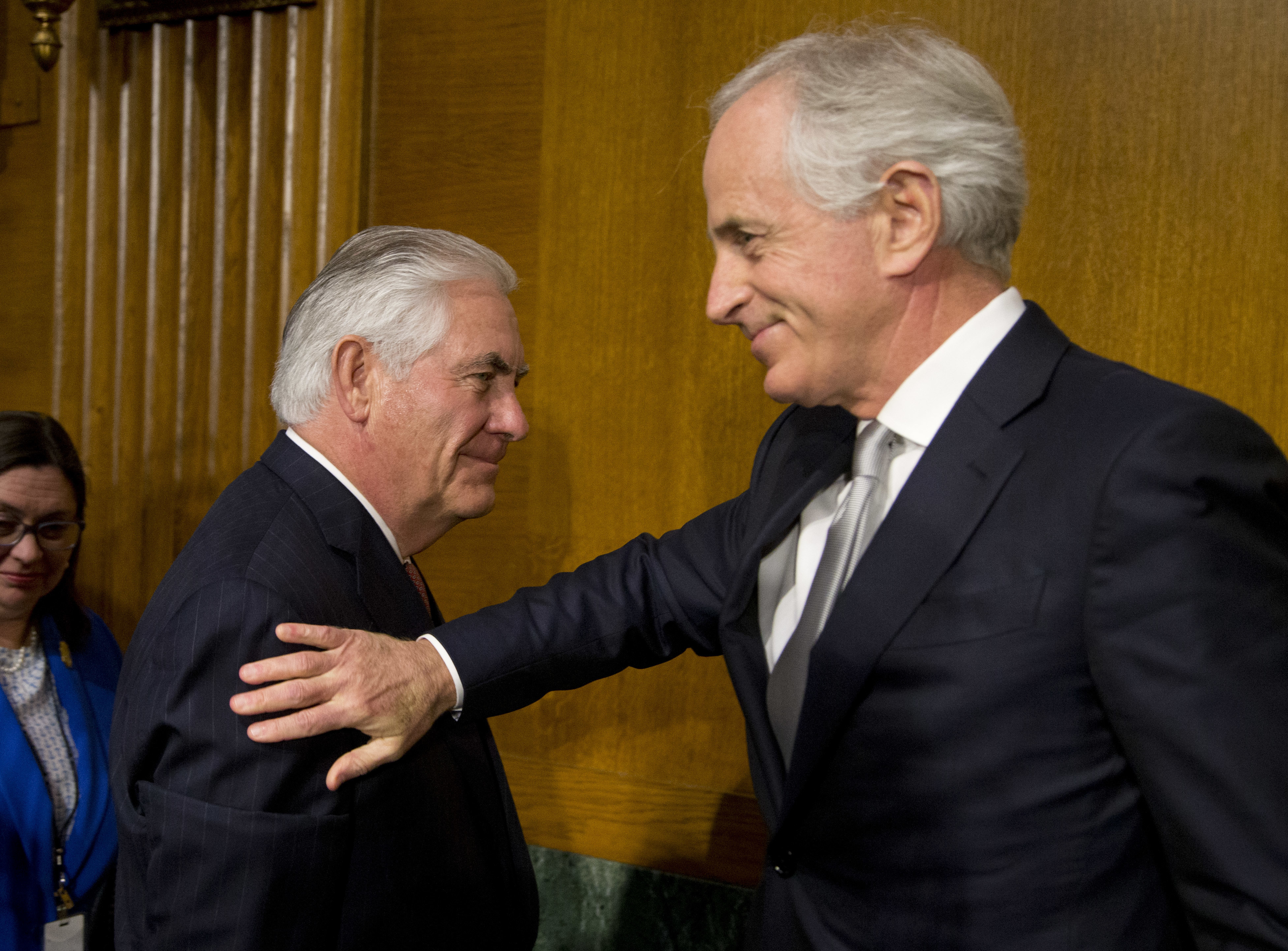 Sen. Bob Corker, R-Tenn., chairman of the Senate Foreign Relations Committee (R) pats Secretary of State-designate Rex Tillerson (L) on the shoulder after his testimony before the Senate Foreign Relations Committee on Capitol Hill in Washington on Jan. 11, 2017. (AP Photo/Steve Helber)