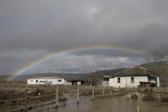 FILE - In this Jan. 11, 2017, file photo, a rainbow is seen over a flooded landscape in Hollister, Calif.  More than 40 percent of California has emerged from a punishing drought that covered the whole state a year ago, federal drought-watchers said Thursday, Jan. 12, a stunning transformation caused by an unrelenting series of storms in the North that filled lakes, overflowed rivers and buried mountains in snow. (AP Photo/Marcio Jose Sanchez, File)
