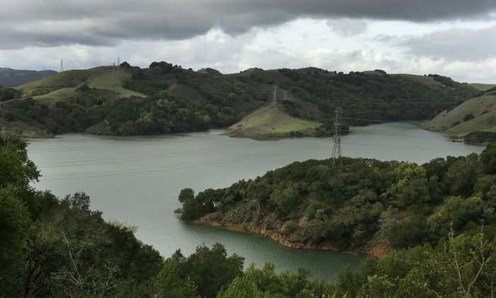 In this Wednesday, Jan. 11, 2017, photo, Briones Reservoir is seen near capacity in Orinda, Calif.  More than 40 percent of California has emerged from a punishing drought that covered the whole state a year ago, federal drought-watchers said Thursday, Jan. 12,  a stunning transformation caused by an unrelenting series of storms in the North that filled lakes, overflowed rivers and buried mountains in snow. (AP Photo/Ben Margot)