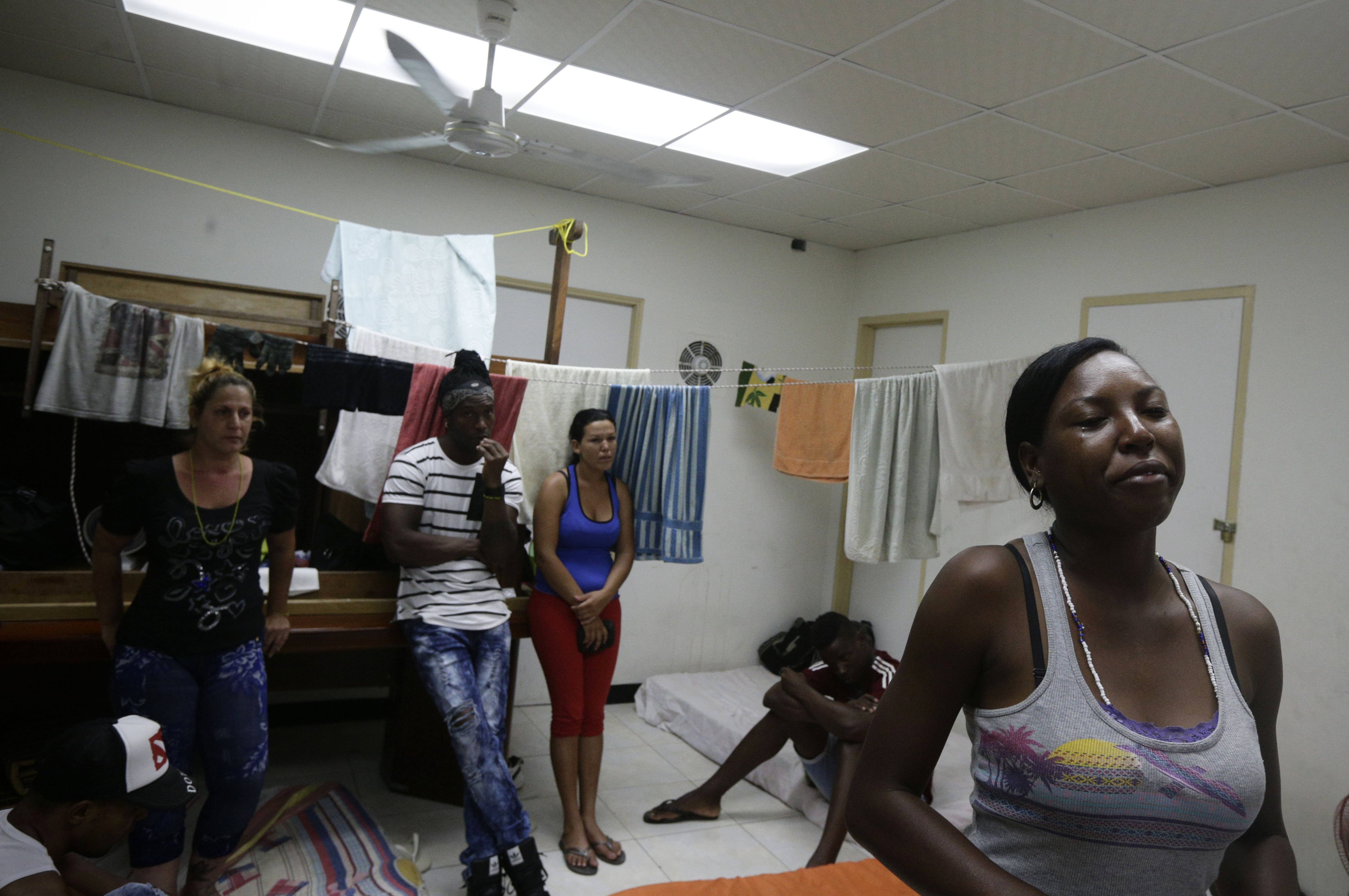 Cuban migrant Yarisel Isac Wilson, 20 (R) cries as she talks about her journey to the U.S. at a migrant shelter in Panama City on Jan. 12, 2017. (AP Photo/Arnulfo Franco)