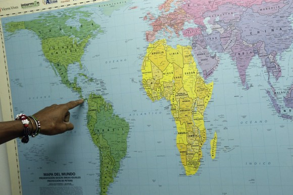 Cuban migrant Ulises Ferrer, 39, points out his route to the U.S., during his stay at a shelter in Panama City on Jan. 12, 2017. (AP Photo/Arnulfo Franco)