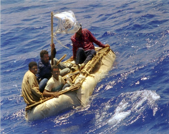 Cuban refugees float in seas, 60 miles south of Key West, Fla. in this Aug. 26, 1994 file photo. (AP Photo/Dave Martin, File)