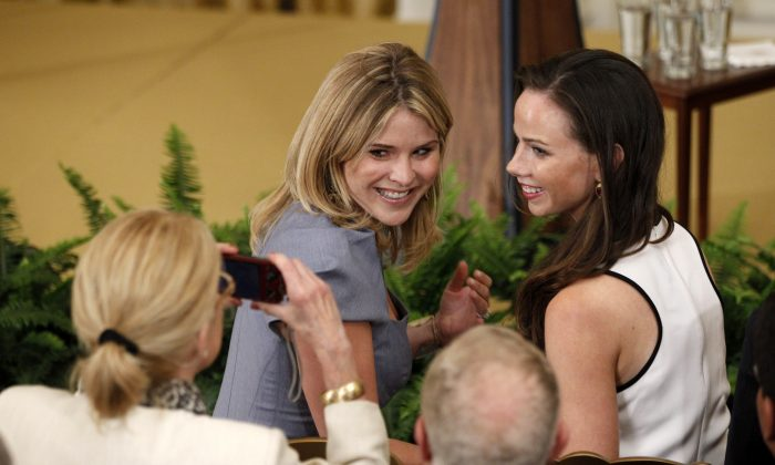 Former President George W. Bush's daughters Jenna and Barbara have their photo taken in the East Room at the White House in Washington prior to the unveiling of President Bush's official portrait. (AP Photo/Charles Dharapak, File)