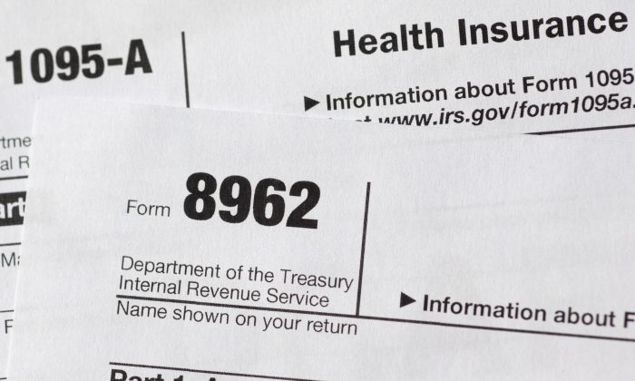 Tax form 8962 is seen in Washington, in this file photo. (AP Photo/Carolyn Kaster)