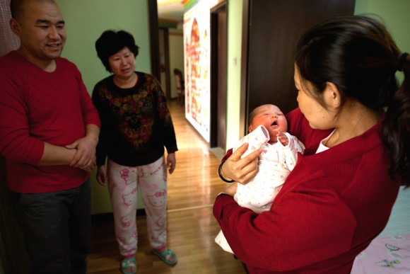 A woman holds a newborn girl at the Antai maternity hospital in Beijing on Jan. 26, 2012.  (Ed Jones/AFP/Getty Images)