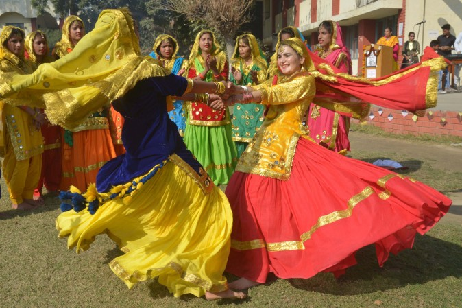 Young Indian students wear traditional Punjabi dress as they perform the 'Giddha' dance during celebrations on the occasion of the Lohri Festival in Amritsar on Jan. 13, 2017. (Narinder Narinder/AFP/Getty Images)