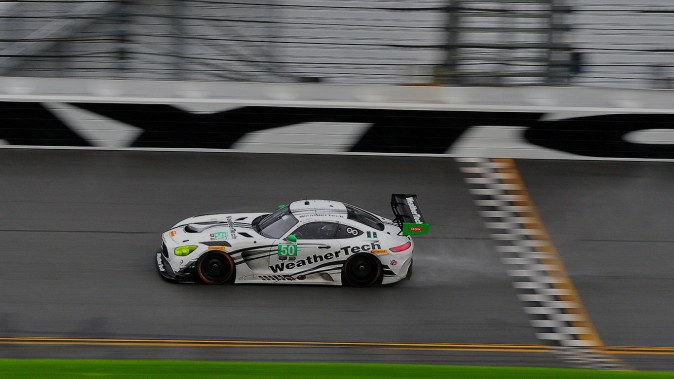 The #50 Riley Motorsports-WeatherTech Racing Mercedes AMG GT3 tests its limits on the wet track. (Bill Kent/Epoch Times)