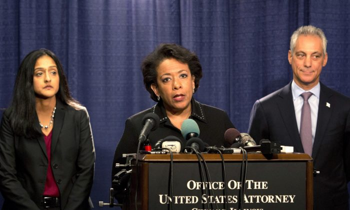 Attorney General Loretta Lynch speaks during a news conference accompanied by Principal Deputy Assistant Attorney General Vanita Gupta, left, and Chicago Mayor Rahm Emanuel, in Chicago, on Friday, Jan. 13, 2017. (AP Photo/Teresa Crawford)