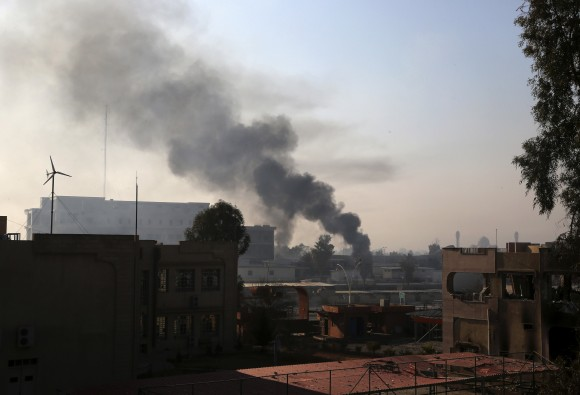Smoke rises as Iraqi security forces fight against Islamic State militants inside Mosul University, in the eastern side of Mosul, Iraq on Jan. 14, 2017. (AP Photo/ Khalid Mohammed)