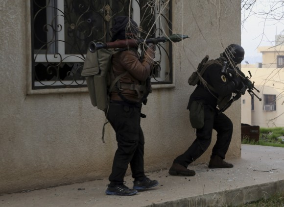 Iraqi special forces fight against Islamic State militants to regain control of Mosul University, in the eastern side of Mosul, Iraq on Jan. 14, 2017. (AP Photo/ Khalid Mohammed)