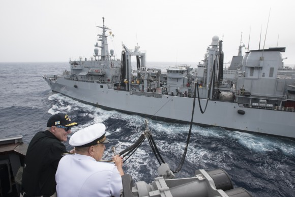 Secretary of the Navy (SECNAV) Ray Mabus, left, observes an underway replenishment with Adm. Giuseppe De Giorgi, chief of the Italian navy, while aboard the guided-missile destroyer USS Mason (DDG 87) on June 16, 2016. This was the U.S. Navy's first replenishment where the fuel was made from alternative sources and transferred from a partner nations ship. The Italian navy auxiliary ship ITS Etna (A5326) provided Mason with biofuel, made from waste fat beef and inedible vegetable oil, as part of the Great Green Fleet initiative. (Armando Gonzales/US Navy/Getty Images)