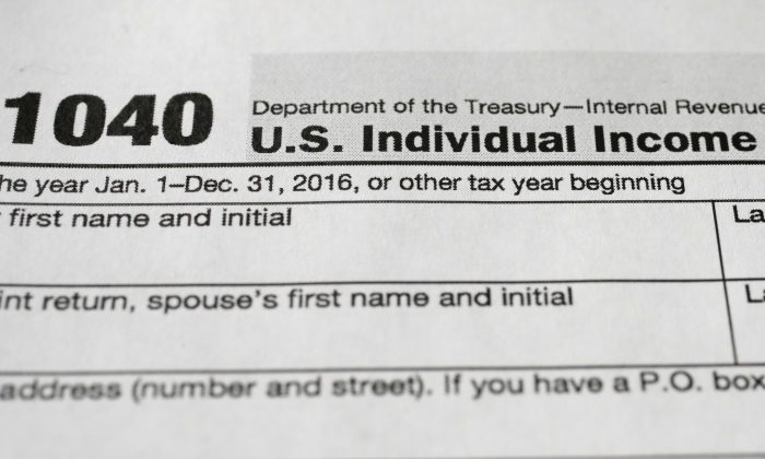 A 1040 tax form, in New York. (AP Photo/Mark Lennihan)