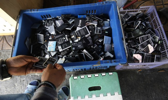 Discarded, second-hand electronics are sold on a sidewalk Bangkok, Thailand, on Jan, 12, 2017. (AP Photo/Sakchai Lalit)