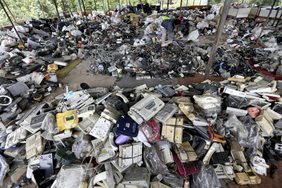 A customer browses through used items at a flea market on the outskirts of Jakarta, Indonesia, on Jan. 13, 2017. (AP Photo/Tatan Syuflana)