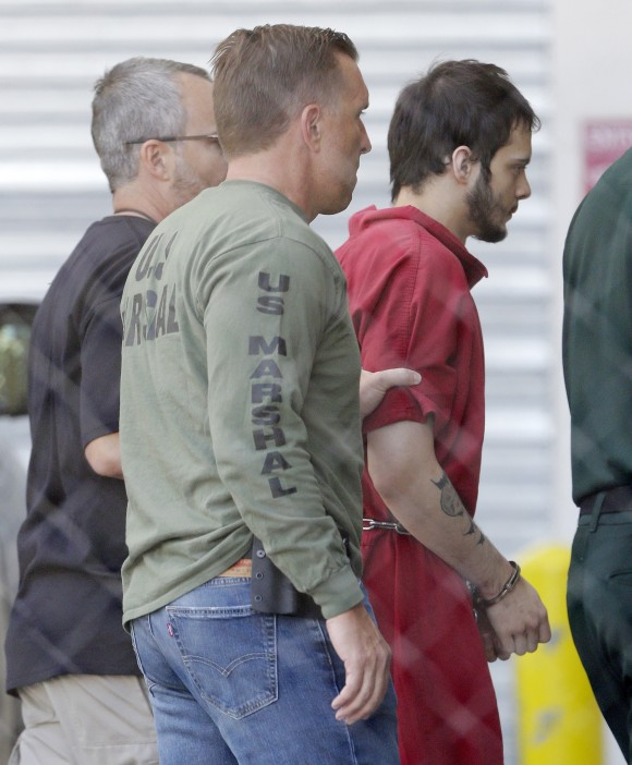 In this file photo, Esteban Santiago, right, accused of fatally shooting several people and wounding multiple others at a crowded Florida airport baggage claim, is returned to Broward County's main jail after his first court appearance in Fort Lauderdale, Fla., on Jan. 9, 2017. (AP Photo/Alan Diaz)