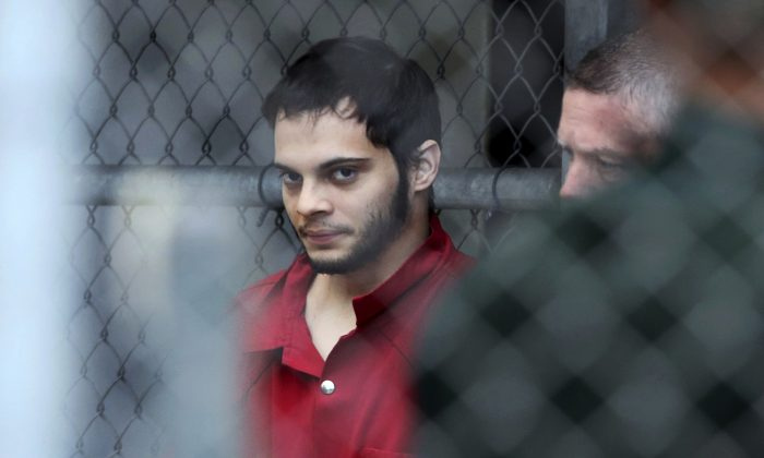 In this file photo, Esteban Santiago is taken from the Broward County main jail as he is transported to the federal courthouse in Fort Lauderdale, Fla., on Jan. 9, 2017. (Amy Beth Bennett/South Florida Sun-Sentinel via AP)