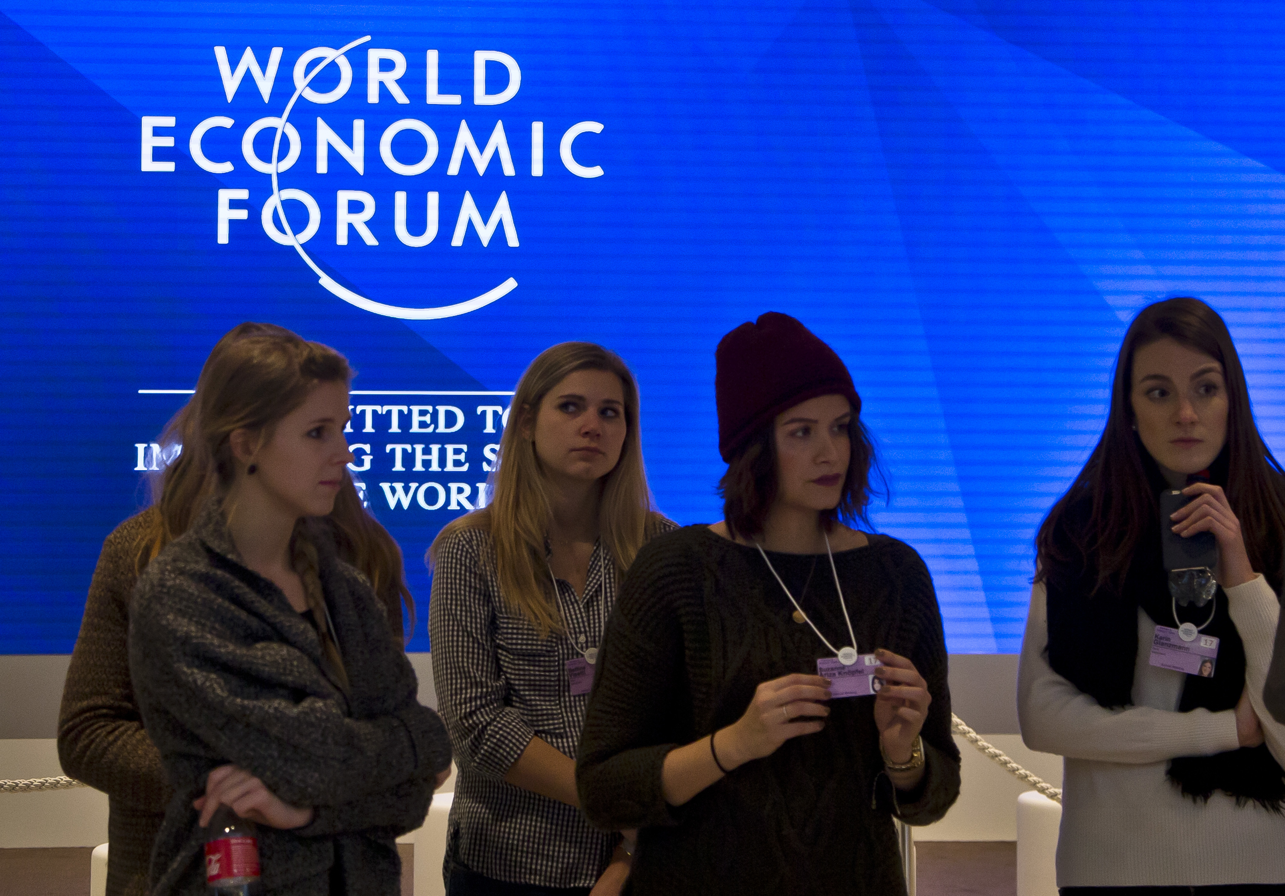 Staff members are briefed at the congress center where the annual meeting, World Economic Forum, will take place in Davos, Switzerland on Jan. 15, 2017. (AP Photo/Michel Euler)