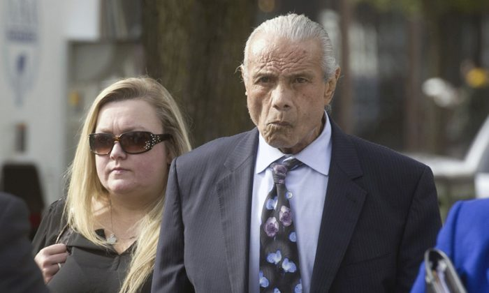 """FILE – In this Nov. 2, 2015, file photo, former professional wrestler Jimmy """"Superfly"""" Snuka, right, arrives for his formal arraignment at the Lehigh County Courthouse in Allentown, Pa. In a decision filed Tuesday, Jan. 3, 2017, a Pennsylvania judge dismissed the murder case against Snuka in the 1983 death of his girlfriend Nancy Argentino, saying Snuka is not competent to stand trial on counts including third-degree murder. Snuka's attorney told a judge in December 2016 that his client is in hospice care in Florida and has six months to live. (Michael Kubel/The Morning Call via AP, File)"""
