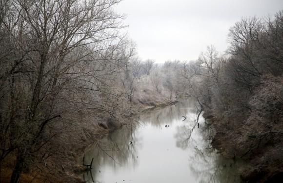 Ice hangs from trees along a creek bed in North Tulsa, on Jan. 14, 2017. (Jessie Wardarski/Tulsa World via AP)
