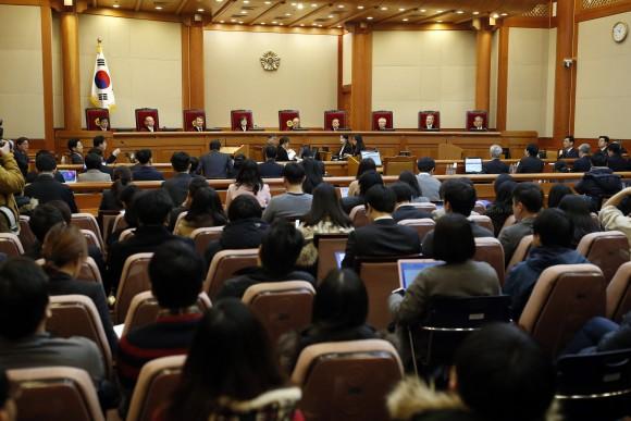 Nine judges of South Korea's Constitutional Court sit during hearing arguments for South Korean President Park Geun-hye's impeachment trial at the Constitutional Court in Seoul, South Korea, on Jan. 16, 2017. (Kim Hong-ji/Pool Photo via AP)