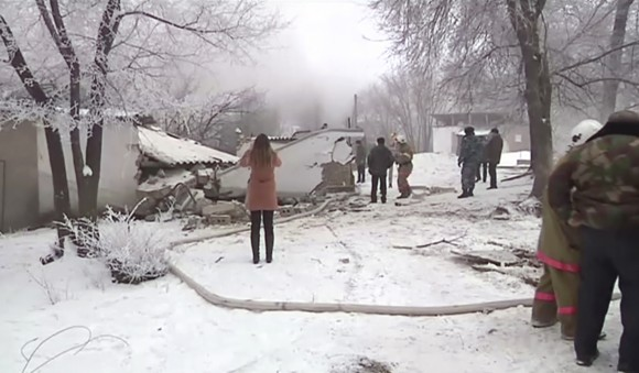 Rescuers and people watch at a plane crash site outside Bishkek, Kyrgyzstan, on Jan. 16, 2017. (AP Photo)
