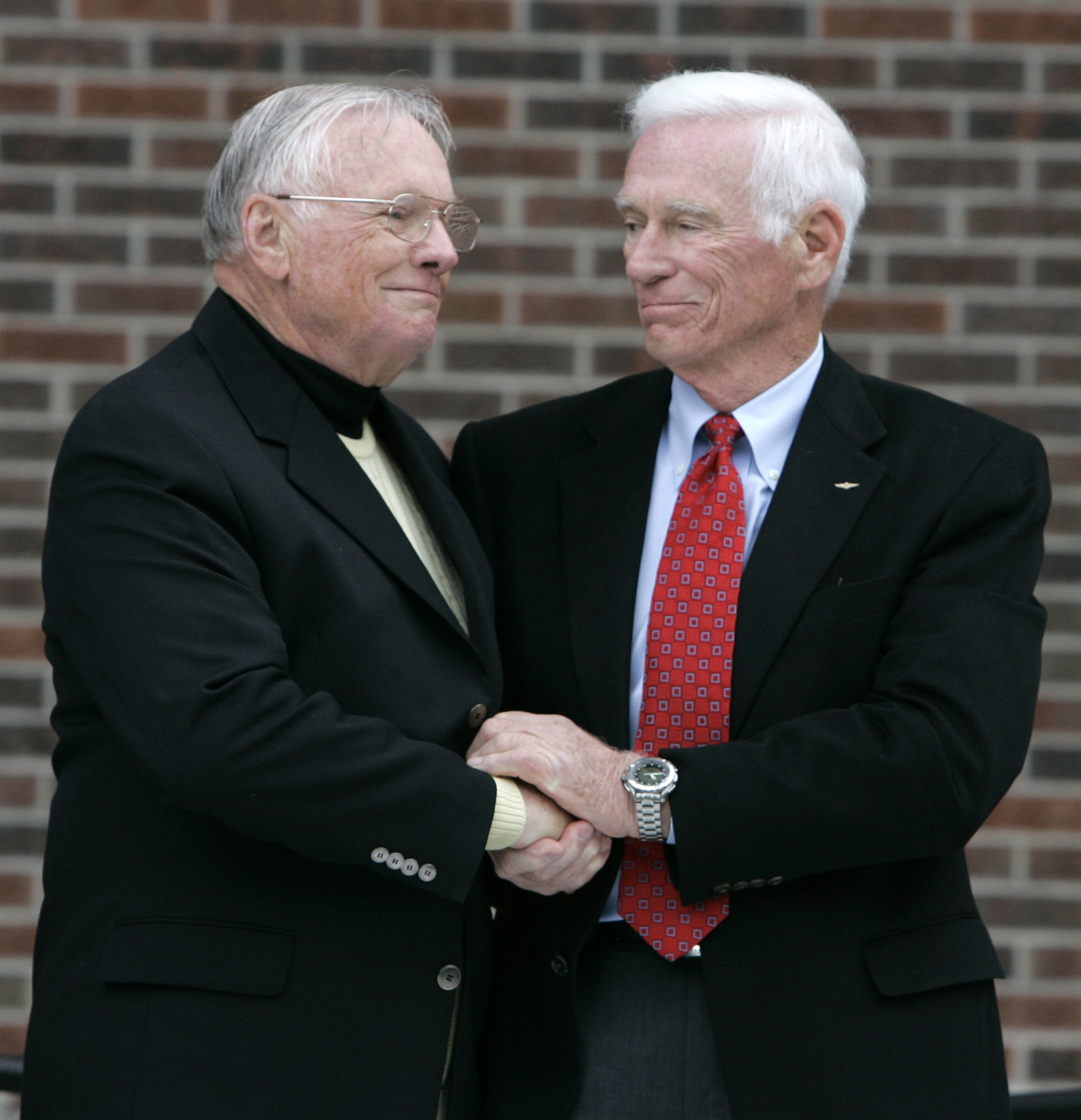 Former astronaut Neil Armstrong (L) is congratulated by fellow ex-astronaut Gene Cernan following the dedication ceremony of the Neil Armstrong Hall of Engineering at Purdue University in West Lafayette, Ind. (AP Photo/Michael Conroy)