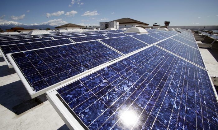 Solar panels on the roof of a Wal-Mart Supercenter in Baldwin Park, Calif., on March 9, 2010.  (AP Photo/Reed Saxon)