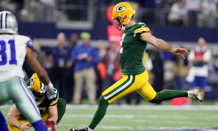 Mason Crosby of the Green Bay Packers kicks the game-winning field goal against the Dallas Cowboys at AT&T Stadium on Jan. 15, 2017 in Arlington, Texas. The game featured four 50-yard field goals. (Tom Pennington/Getty Images)