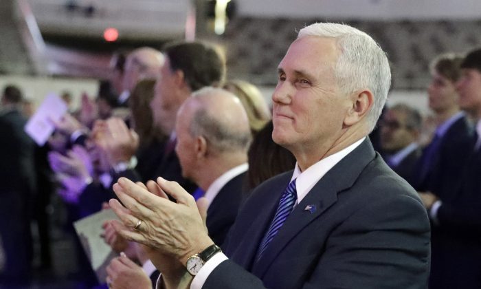 Vice President-elect Mike Pence applauds during the inaugural ceremony for Indiana's statewide office holders, in Indianapolis on Jan. 9, 2017. (AP Photo/Darron Cummings, Pool)
