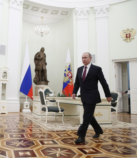 Russian President Vladimir Putin walks to meet with Moldovan President Igor Dodon in Moscow's, Kremlin, Russia on Jan. 17, 2017. Dodson is in Russia on an official visit. (Sergei Ilnitsky/Pool photo via AP)