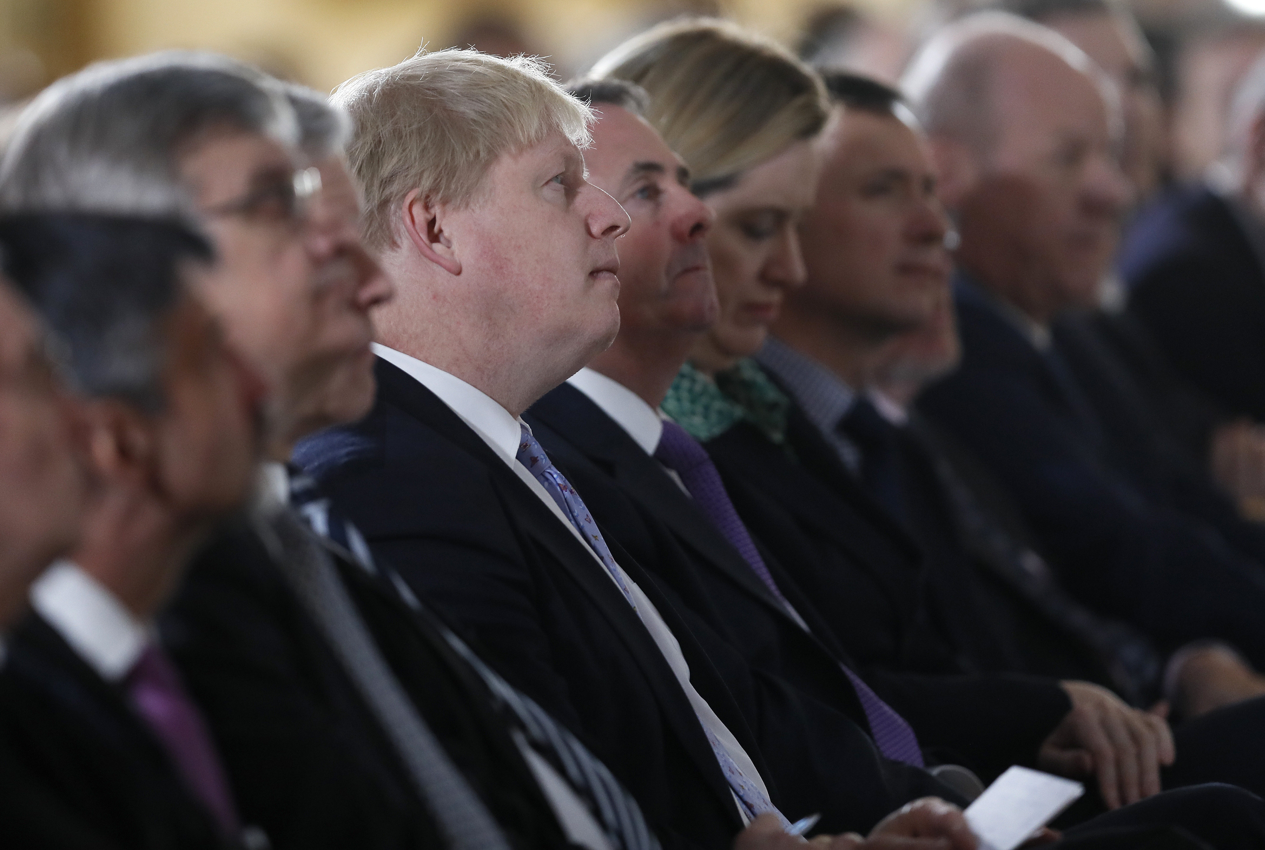 Britain's Foreign Secretary Boris Johnson (C) listens as Prime Minister Theresa May delivers a speech on leaving the European Union at Lancaster House in London on Jan. 17, 2017. (AP Photo/Kirsty Wigglesworth, pool)