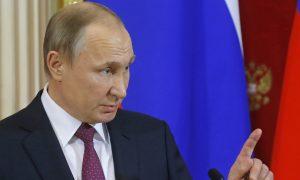 Putin: Obama's Government Is Working Hard to Undermine Trump