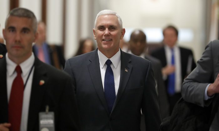Vice President-elect Mike Pence walks through the halls of Russell Senate Office Building on Capitol Hill in Washington on Jan. 17, 2017. (AP Photo/Carolyn Kaster)