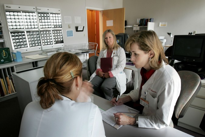 Doctors review the results of PET scans of a patient being treated at the Kimmel Comprehensive Cancer Center at Johns Hopkins in Baltimore, Md., in this file photo. (Win McNamee/Getty Images)
