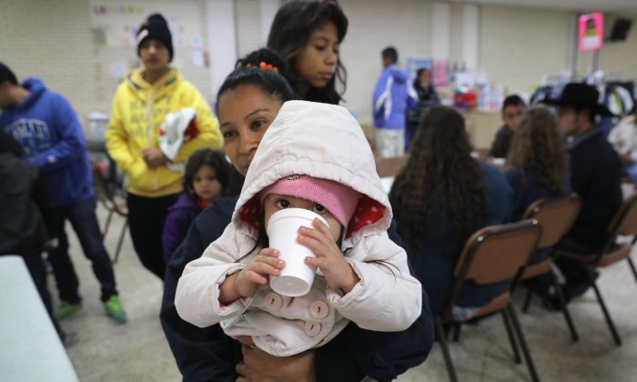 Immigrants who were released by the U.S. Customs and Border Protection, eat a Three Kings day meal at the Catholic Charities Respite Center in McAllen, Texas, on Jan. 6.  (John Moore/Getty Images)