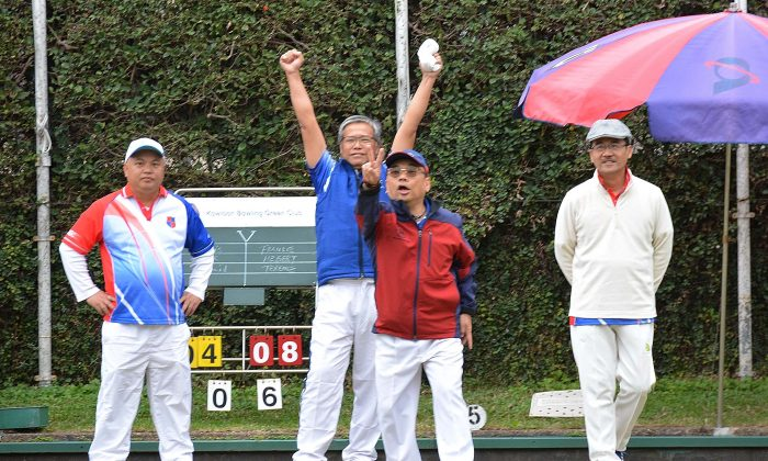At KBGC on Saturday Jan 14, Frankie Siu and Herbert Kwok of HKFC-A cheer as their skip Terrence Lee (not in photo) wins the end with a score of 2 against KBGC-A. HKFC-A won the game 6/2 to take them into 3rd place in the table only 1 point behind HKFC-B and 5 points behind leaders CCC-A. (Stephanie Worth)
