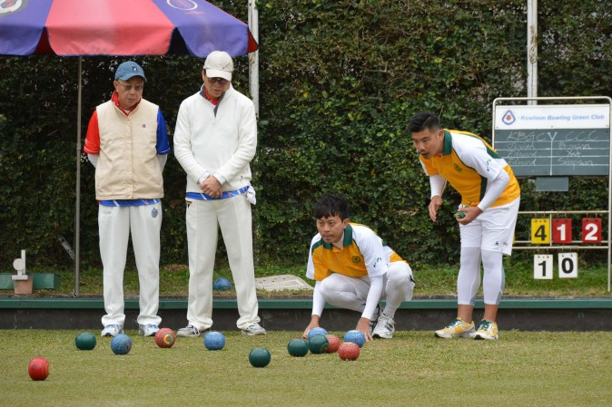 Wong Chun Yat and Bronson Fung of CCC-A closely watch their skip Simpson Chang's wood enter the head in the Triples League match against KBGC-B on Sat Jan 14, 2017. Chang's rink won easily, 23 to 4, to take 2 points and also provided the aggregate score of 2 points to CCC. (Stephanie Worth.)