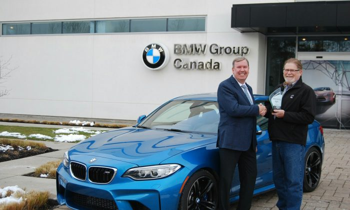 (Left: Hans Blesse, president and CEO of BMW Group Canada, Right: David Taylor, CCOTY Committee Member) (David Taylor)
