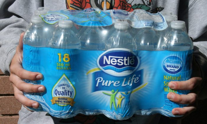 Ontario is proposing to charge water-bottling companies a little over $500 per million litres, up from the current fee of $3.71. (The Canadian Press/Richard Buchan)