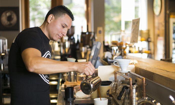 Cesar Jara, coffee supervisor at Brazilia Cafe, makes coffee using an AeroPress, in NoHo, Manhattan, on Oct. 14, 2014. (Samira Bouaou/Epoch Times)