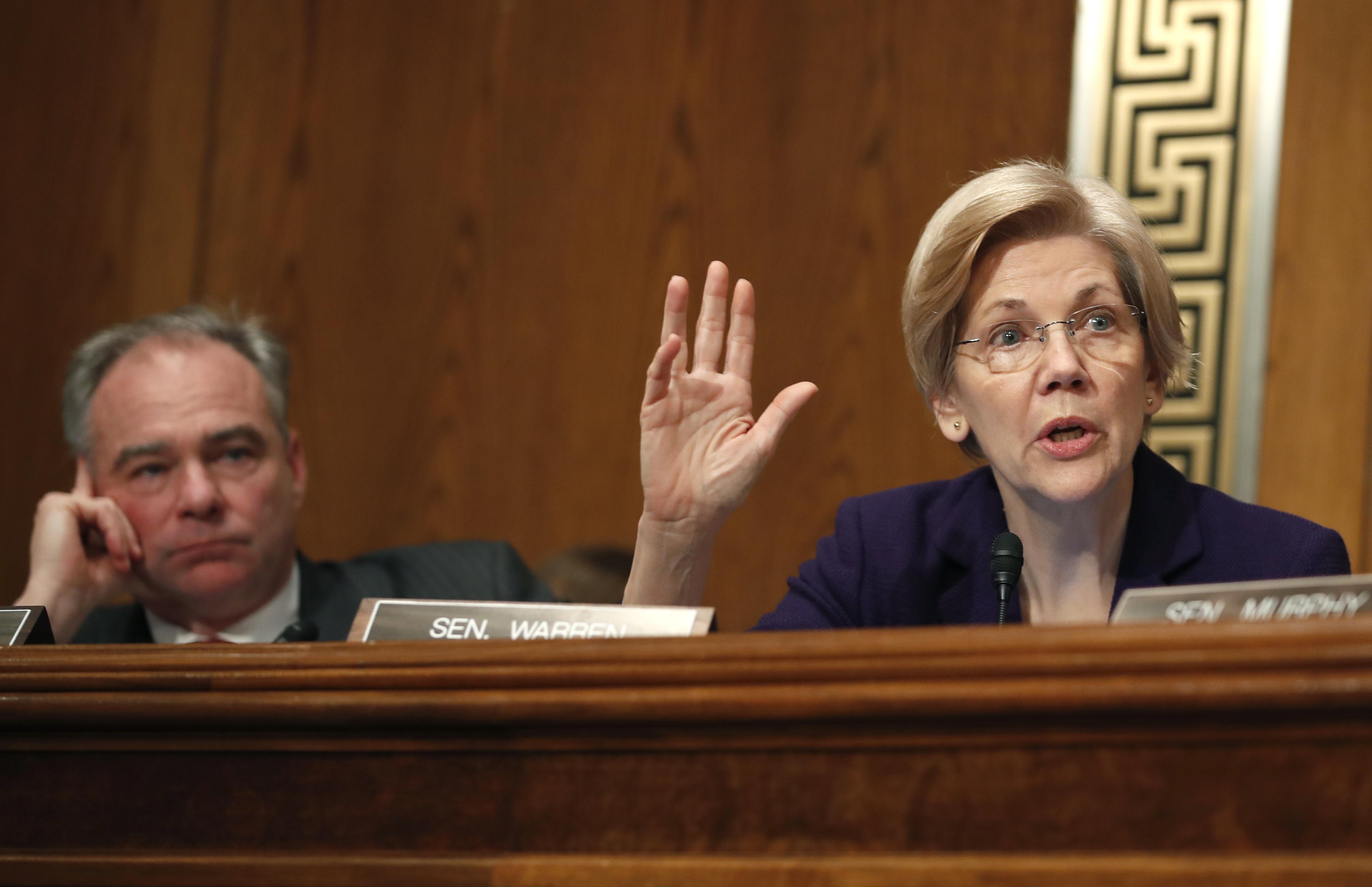 Sen. Elizabeth Warren, D-Mass., questions Education Secretary-designate Betsy DeVos on Capitol Hill in Washington on Jan. 17, 2017. (AP Photo/Carolyn Kaster)