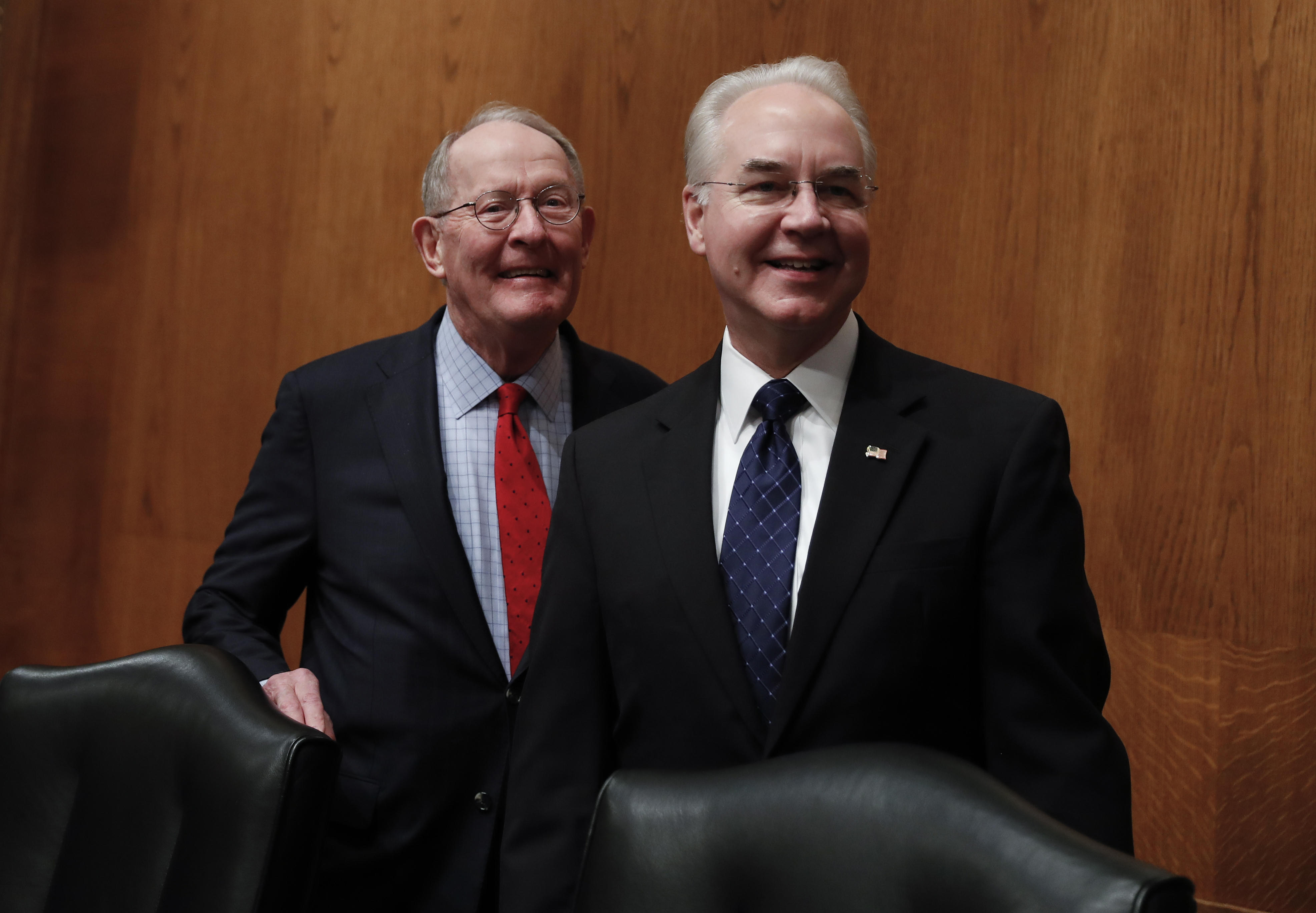 Senate Health, Education, Labor and Pensions Committee Chairman Sen. Lamar Alexander, R-Tenn. (L) stands with Health and Human Services Secretary-designate, Rep. Tom Price, R-Ga. on Capitol Hill in Washington on Jan. 18, 2017.  (AP Photo/Carolyn Kaster)