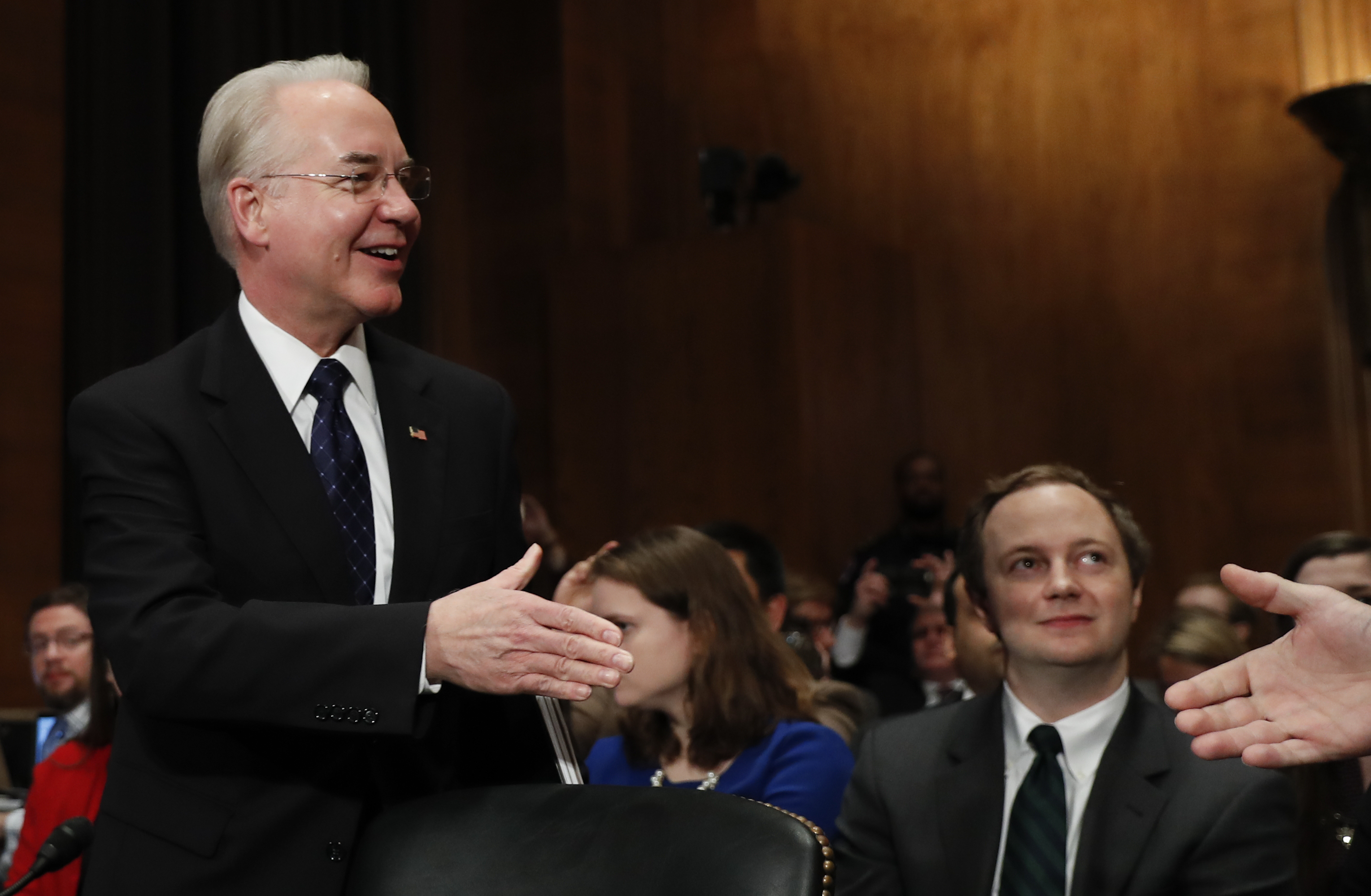 Health and Human Services Secretary-designate, Rep. Tom Price, R-Ga. (L) is greeted on Capitol Hill in Washington on Jan. 18, 2017, prior to testifying his confirmation hearing before the Senate Health, Education, Labor and Pensions Committee. (AP Photo/Carolyn Kaster)