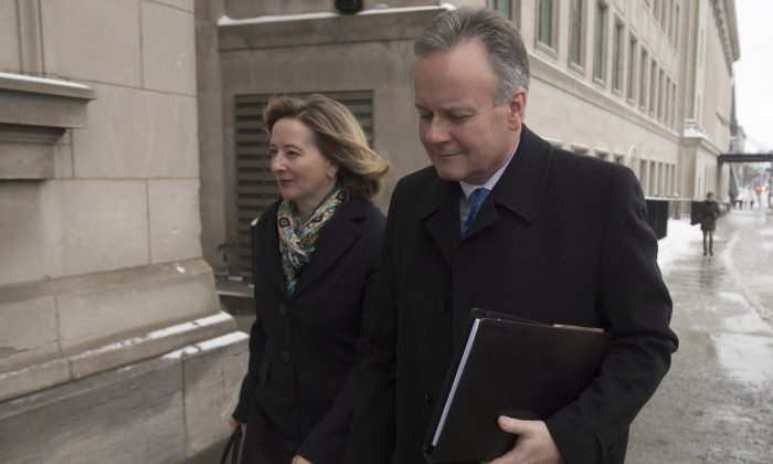 BankofCanadaGovernor Stephen Poloz and Senior Deputy Governor Carolyn Wilkins arrive for a press conference in Ottawa on Jan. 18, 2017. The centralbankannounced that it would hold its key interest rate at 0.5 percent. (The Canadian Press/Adrian Wyld)