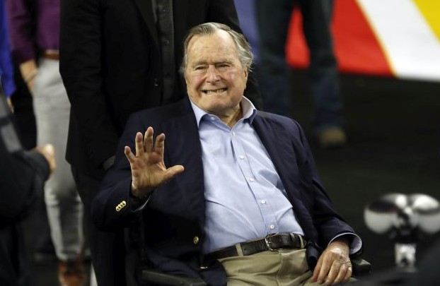 In this April 2, 2016, file photo, former President George H. W. Bush waves as he arrives at NRG Stadium before the NCAA Final Four tournament college basketball semifinal game between Villanova and Oklahoma in Houston. Houston-area media are quoting former President George H.W. Bush's chief of staff as saying that Bush has been hospitalized in Houston. (AP Photo/David J. Phillip, File)